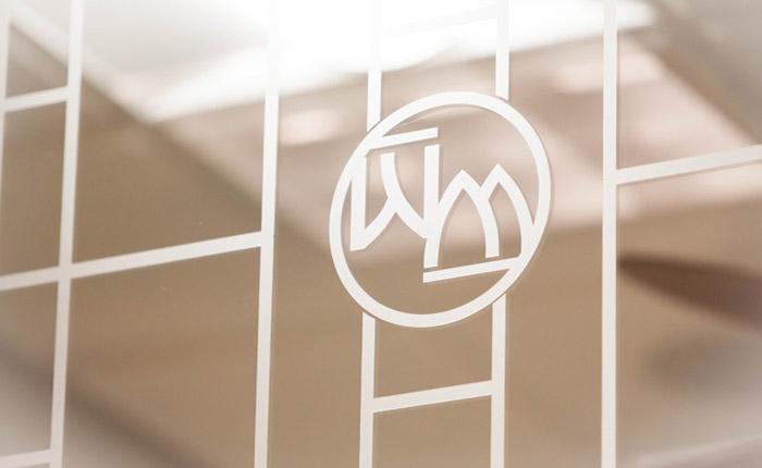 WM logo on a glass window