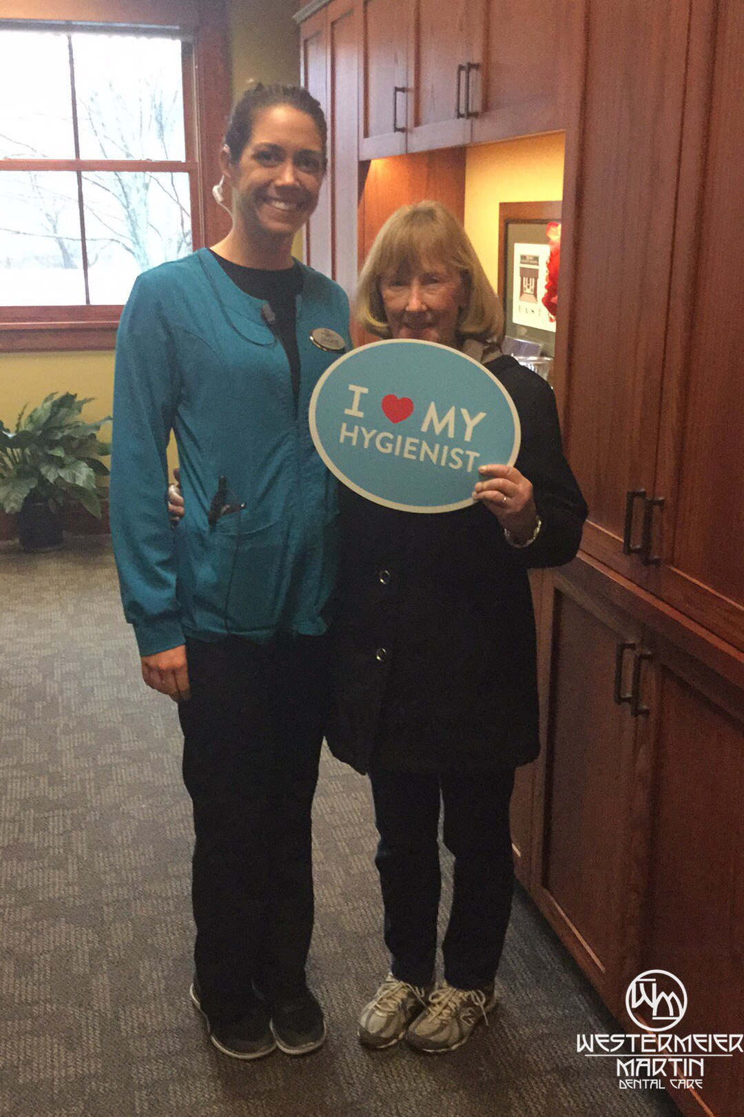 Patient holding an I heart my hygienist