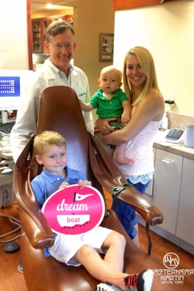 Dr Martin with a happy family of patients