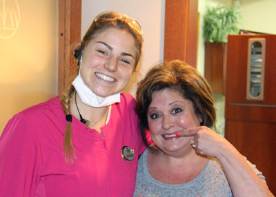 Anne and a patient smiling