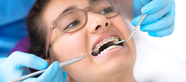 Patient with braces being worked on