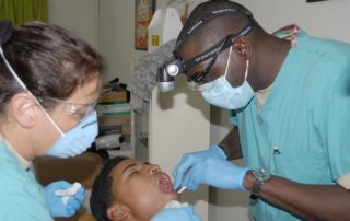 Dentists working on a patient